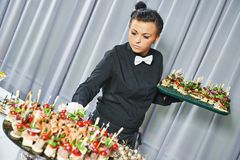 Waiter serving catering table Stock Photos