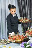 Waiter serving catering table Stock Image