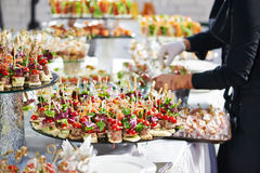 Waiter serving catering table in restaurant Royalty Free Stock Photography