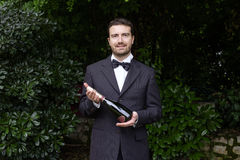 Waiter serving a champagne bottle Royalty Free Stock Photography