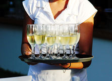 Waiter serving champagne Royalty Free Stock Images