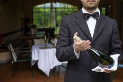 Waiter serving champagne flutes during a celebration Royalty Free Stock Image