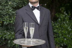 Waiter serving champagne flutes during a celebration Royalty Free Stock Photos