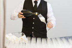 Waiter serving champagne flutes Stock Images