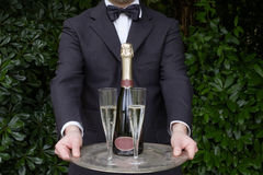 Waiter serving champagne. Waiter in formal dress serving champagne Stock Photos