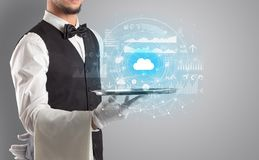 Waiter serving cloud technology concept. Elegant young waiter serving cloud technology concept stock photos