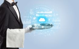 Waiter serving cloud technology concept. Elegant young waiter serving cloud technology conceptn stock photos