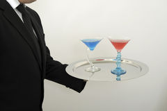 Waiter serving cocktails on a tray Stock Photo