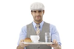 Waiter serving coffee Stock Photo
