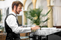 Waiter serving coffee cups Royalty Free Stock Photography