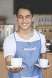 Waiter serving coffee Royalty Free Stock Photo