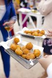 Waiter serving croquettes appetizers stock image