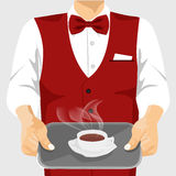 Waiter serving cup of coffee on silver tray Royalty Free Stock Photos