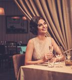 Waiter serving cup of coffee to beautiful woman guest in a restaurant. Stock Images