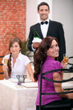 Waiter serving customers Royalty Free Stock Photography