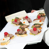 Waiter serving finger food, tapas and appetizers Stock Images