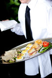 Waiter serving food Royalty Free Stock Image
