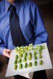 Waiter serving food stock images