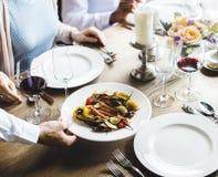 Waiter Serving Food Main Dish to Customers Royalty Free Stock Photo