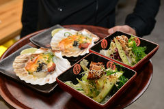 Waiter serving food Stock Image