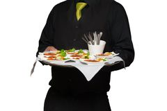 Waiter serving food Stock Photography