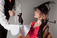 Waiter serving girl Royalty Free Stock Photography