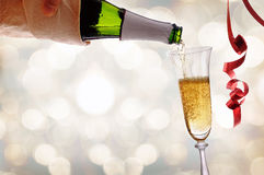 Waiter serving a glass of sparkling white wine with bokeh Royalty Free Stock Photos