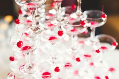 Waiter serving glasses with champagne on a tray.  Stock Images