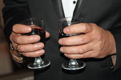 Waiter serving glasses of red wine Stock Image