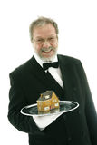 Waiter serving a house Stock Photography