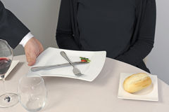 Waiter serving a plate Stock Images