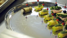 Waiter is serving plate with canape and appetizers. stock video footage