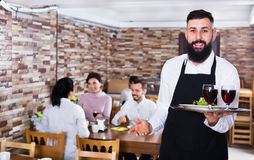 Waiter serving restaurant guests Royalty Free Stock Photo