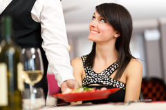 Waiter serving sea food Royalty Free Stock Photo
