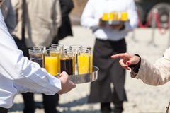 Waiter serving soft drinks at a party Stock Images