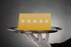 Waiter Serving Star Rating Stock Photography