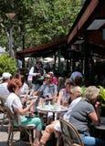 Waiter serving at sunnyTerrace bar Royalty Free Stock Photo