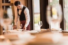 Waiter serving tables stock images