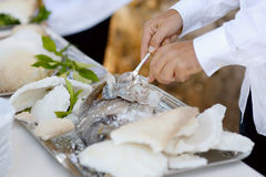Waiter serving a tasty fish Stock Photo