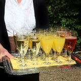 Waiter serving a tray of champagne Stock Photos