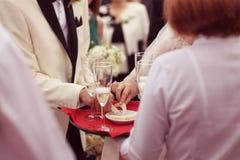 Waiter serving for a wedding. Capture of Waiter serving for a wedding Stock Photo