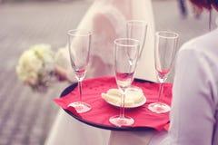 Waiter serving for a wedding. Capture of Waiter serving for a wedding Stock Images