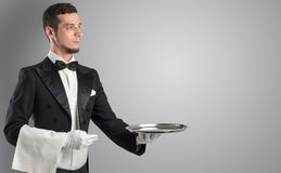 Waiter serving with white gloves and steel tray. In an empty spacen stock images
