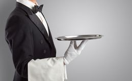 Waiter serving with white gloves and steel tray. In an empty spacen royalty free stock photo