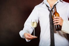 Waiter serving wine bottle. Drink winery liquor relax concept. Waiter serving wine bottle. Steward holds glass with alcohol beverage Royalty Free Stock Photos