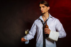 Waiter serving wine bottle. Drink winery liquor relax concept. Waiter serving wine bottle. Steward holds glass with alcohol beverage Royalty Free Stock Images
