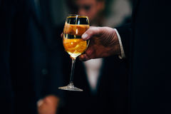Waiter serving wine glasses. Red, White and Champagne glasses at social events. Waiter serving glasses of red and white wine on a waiters plate in black uniform stock image