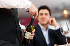 Waiter serving wine Stock Image