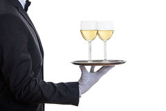 Waiter serving wine on a tray Royalty Free Stock Photos