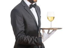 Waiter serving wine on a tray Royalty Free Stock Photo